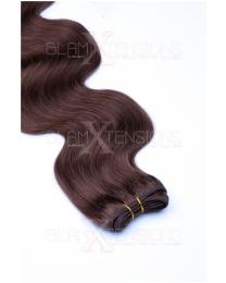 Dieses Bild zeigt die GlamXtensions Weft Extensions Haarverlängerung in der Farbe #06 Mittelbraun in Großansicht. Die echthaar Tressen Extensions sind in vielen verschiedenen Farben erhältlich.