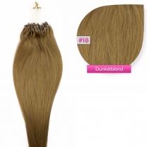 Dieses Bild zeigt die GlamXtensions Microring Extensions Haarverlängerung in der Farbe #18 Dunkelblond in Großansicht. Die echthaar Extensions Bondings haben ein Gewicht von 0,5 Gramm